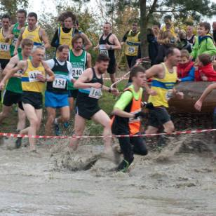 Running through the water trap on the first lap of Chiltern XC League, Match 2, 2014.