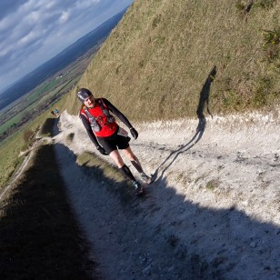 Trev marching up the climb out of CP5, near the top and feeling the pain!